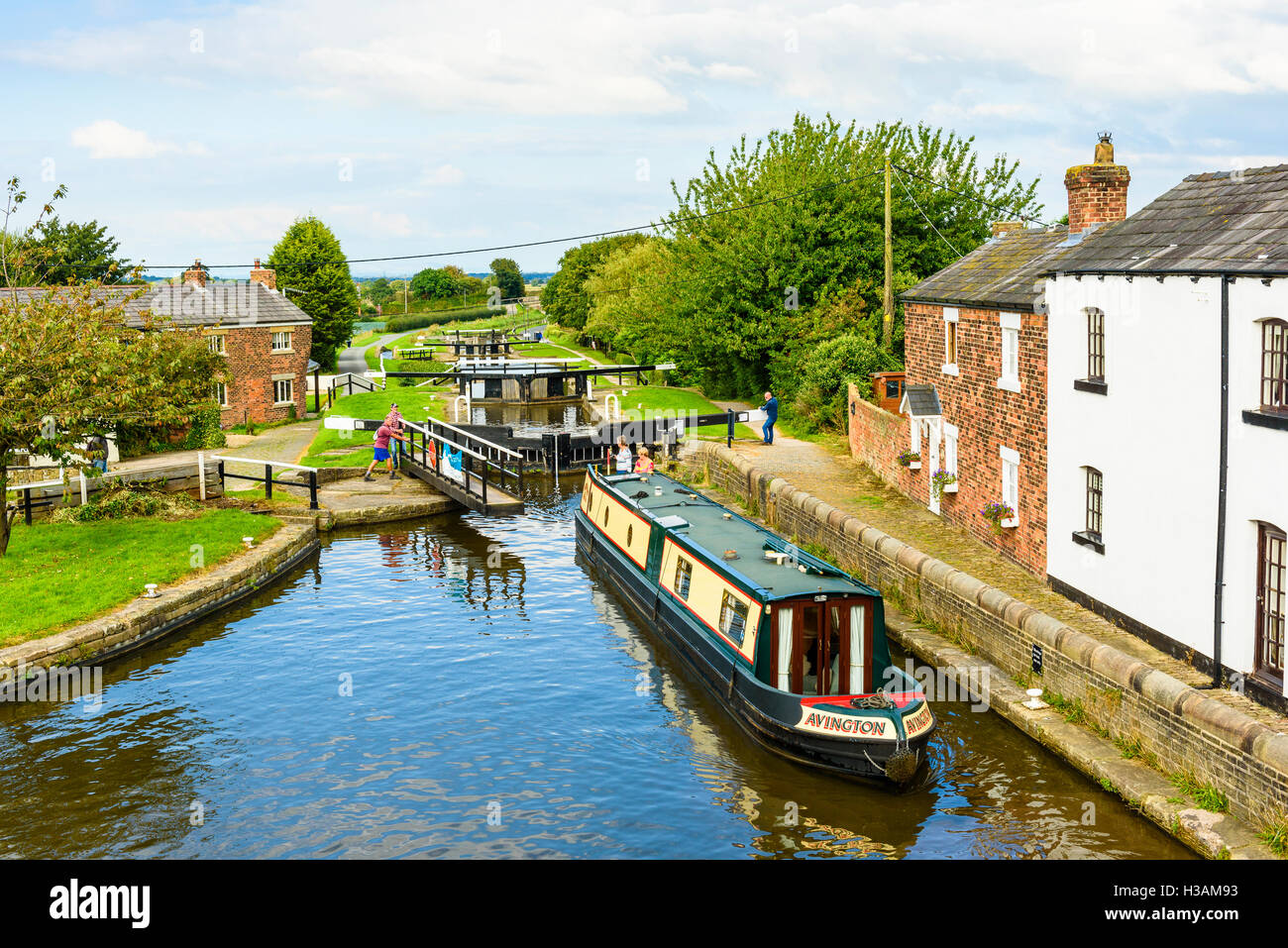 Narrowboat at top lock on the Rufford Branch of the Leeds and Liverpool Canal just outside Burscough in West Lancashire - Stock Image