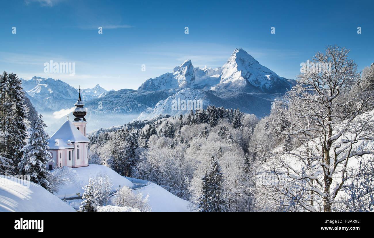 Idyllic winter wonderland in the Alps with pilgrimage church of Maria Gern and famous Watzmann mountain summit, - Stock Image