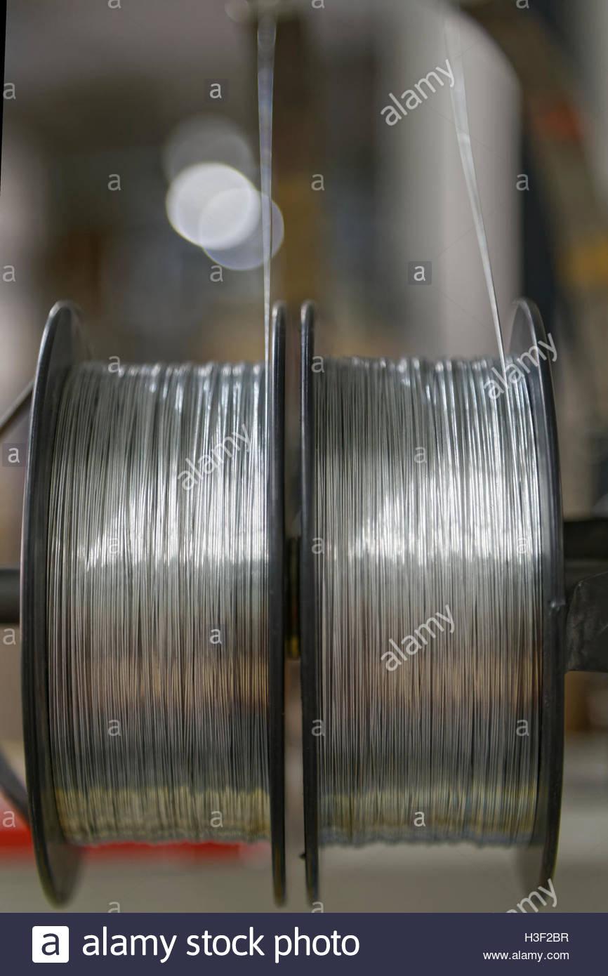 saddle stitch in bindery - Stock Image