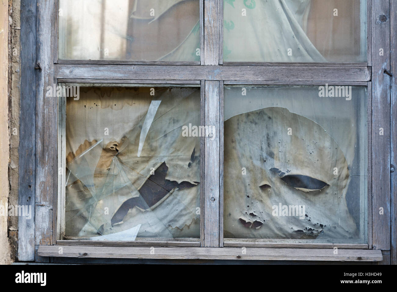 Broken windows and dirty curtains in Viburg Russia Stock Photo