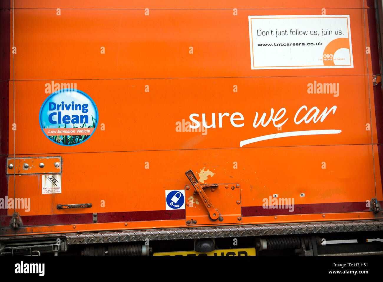tnt van with slogan sure we can,market, delivery, corporation, isuzu, business, wide, shipping, germany, supply, - Stock Image