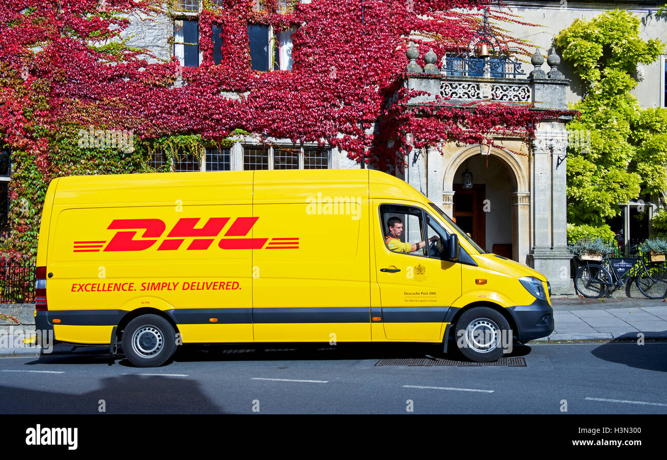 DHL courier van parked outside hotel, England UK Stock Photo