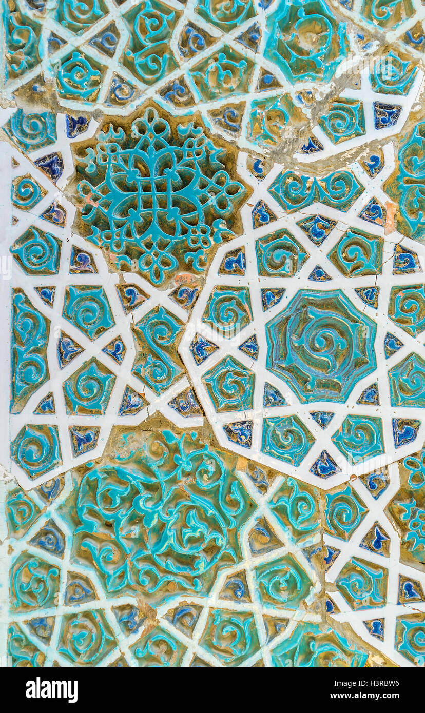The complex pattern on ceramic tile combines elements of geometric ...