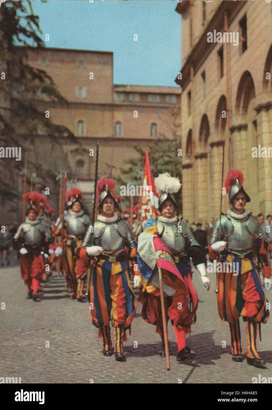 Vintage colour postcard circa 1950s showing the Pontifical Swiss Guard of the Holy See stationed at the Vatican.Stock Photo