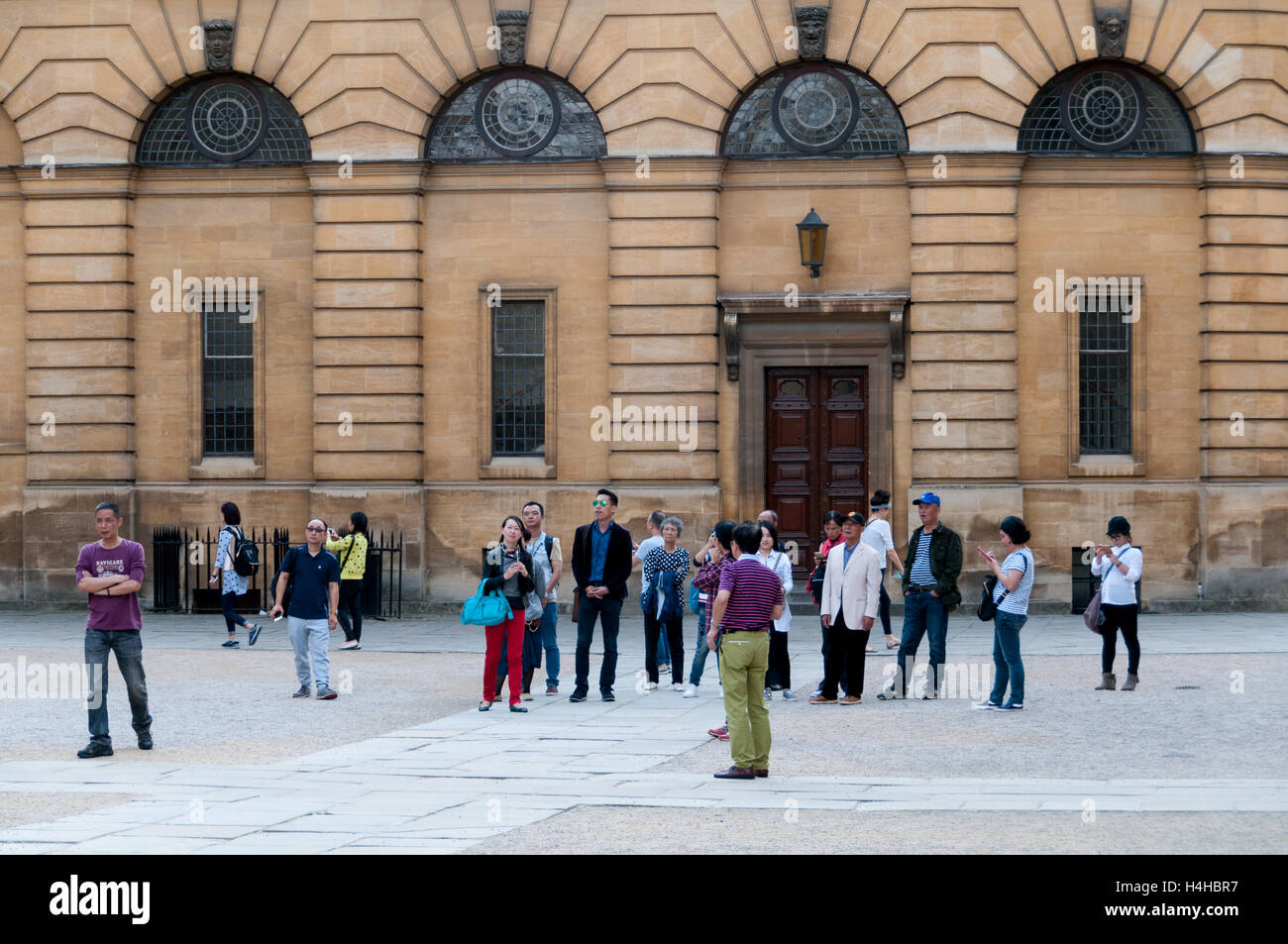 Asian tourists in front of Bodleian Library, Oxford, United KingdomStock Photo