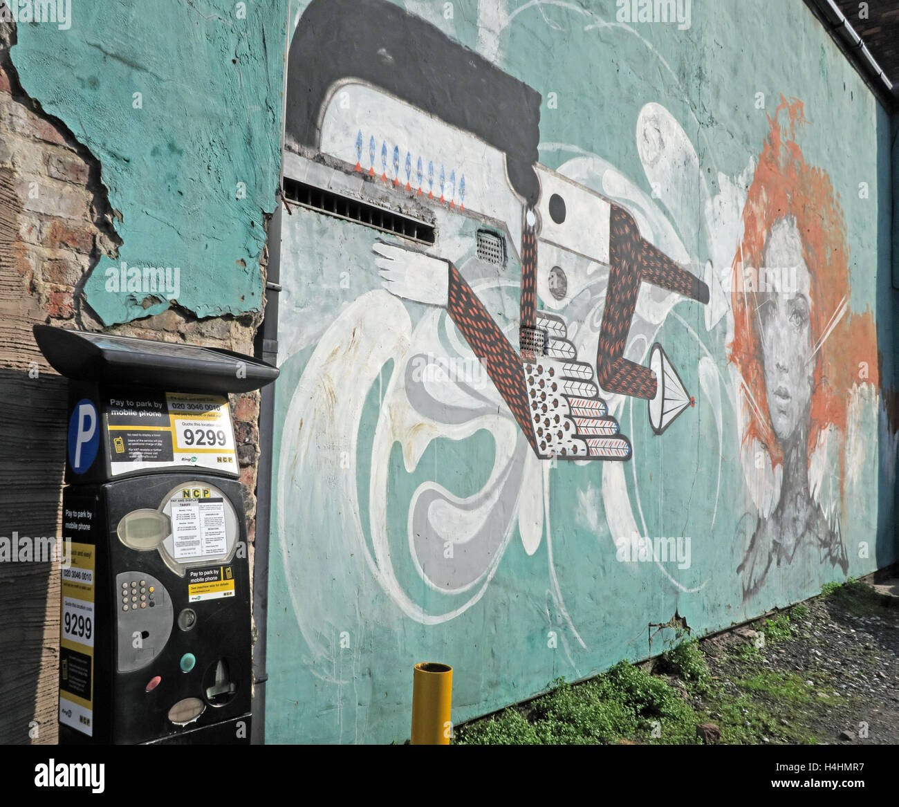 Street,face,faces,mixed,media,car,park,carpark,gun,pipe,drain,drainpipe,wall,gable,gableend,end,with,parking,machine,artistic,urban,gun,Street Art,GoTonySmith,@HotpixUK,Tony,Smith,UK,GB,Great,Britain,United,Kingdom,English,British,England,Buy Pictures of,Buy Images Of,Images of,Stock Images,Tony Smith,United Kingdom,Great Britain,British Isles