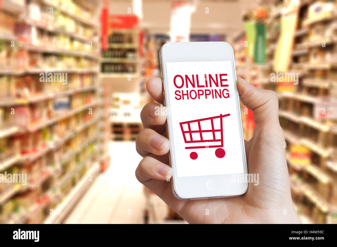 ac45c4731 Online shopping application on mobile phone screen with grocery store in  the background