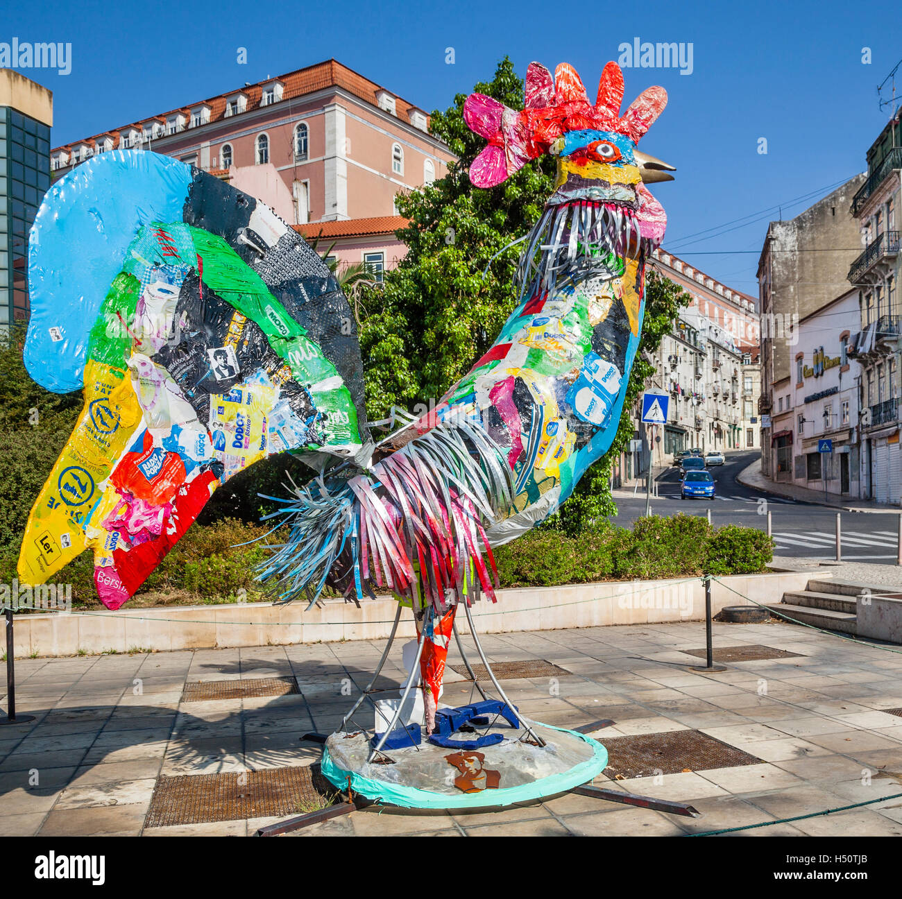 rooster collage sculpture instalation at Largo Martim Moniz, Lisbon, Portugal. The Rooster of Barcelos is an emblem - Stock Image