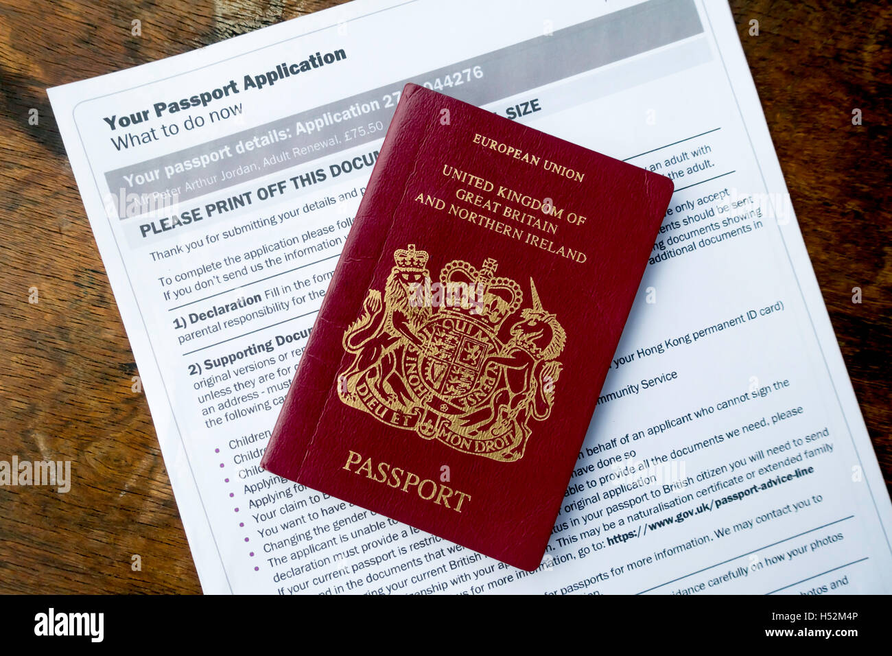 EU United Kingdom Passport with form downloaded as part of the on-line renewal processStock Photo