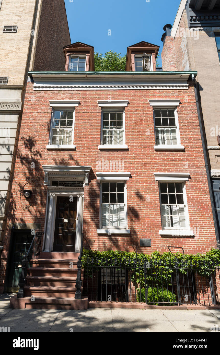 Exterior facade of landmarked Federal style rowhouse townhouse on Charles Street, New York. - Stock Image