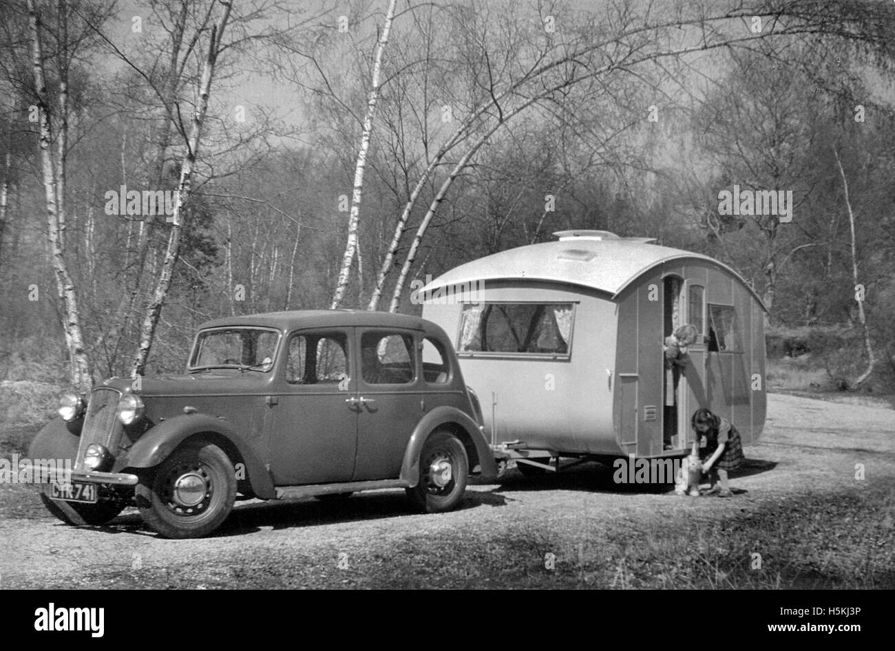 Austin Light 12/4 Ascot saloon with caravan - Stock Image
