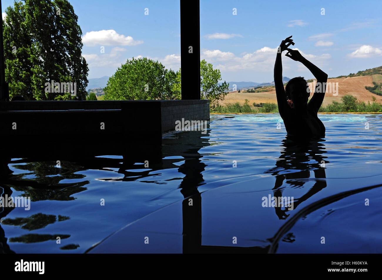 The silhouette of a woman in the thermal indoor pool of the Stock ...