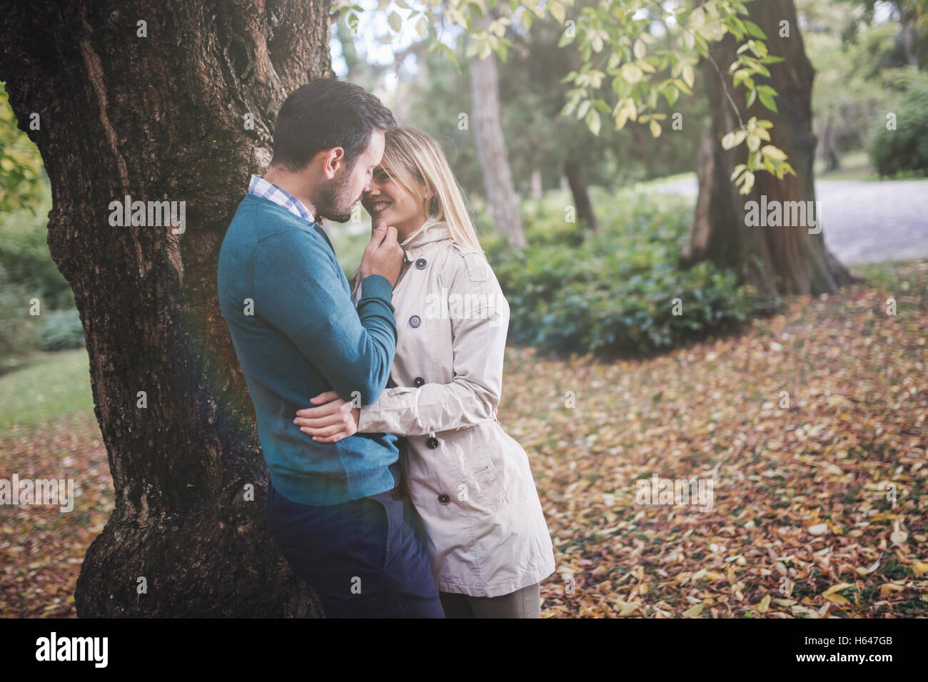 Loving happy couple walking in park - Stock Image