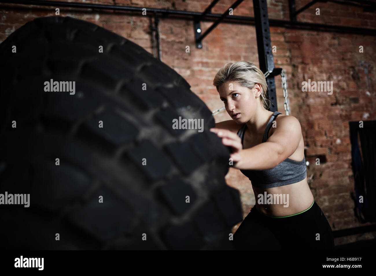 Exercise with tire Stock Photo