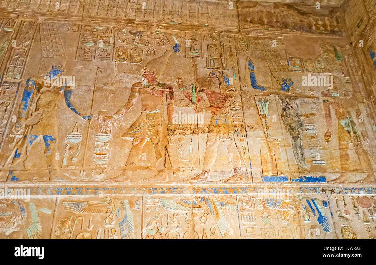 The colorful reliefs with Gods and Pharaohs on the old walls of ...