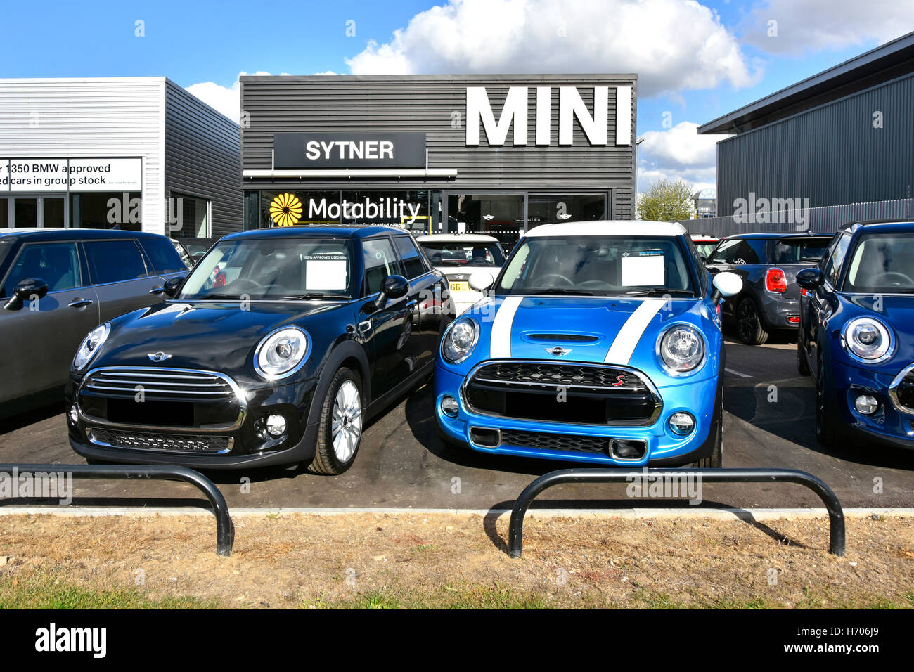 Second hand used car dealer of BMW Mini cars for sale on forecourt ...
