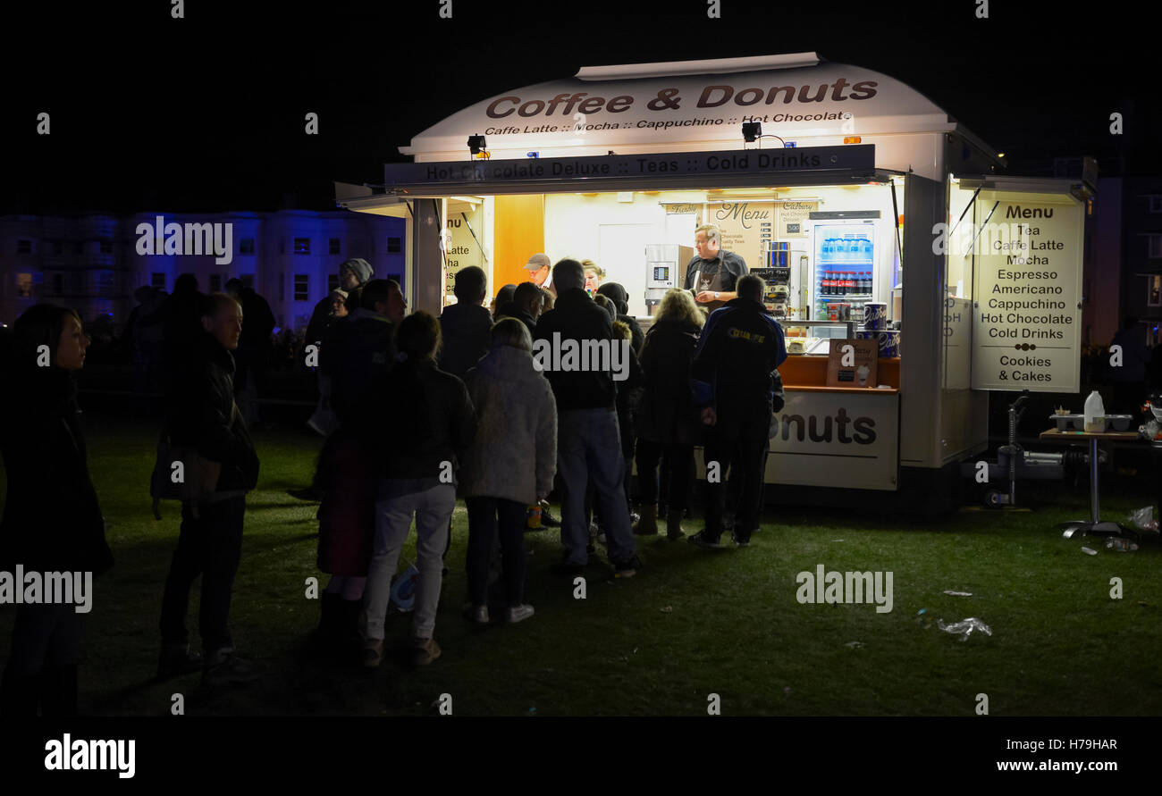 Mobile coffee and donuts refreshments van at night at an outdoor event. - Stock Image