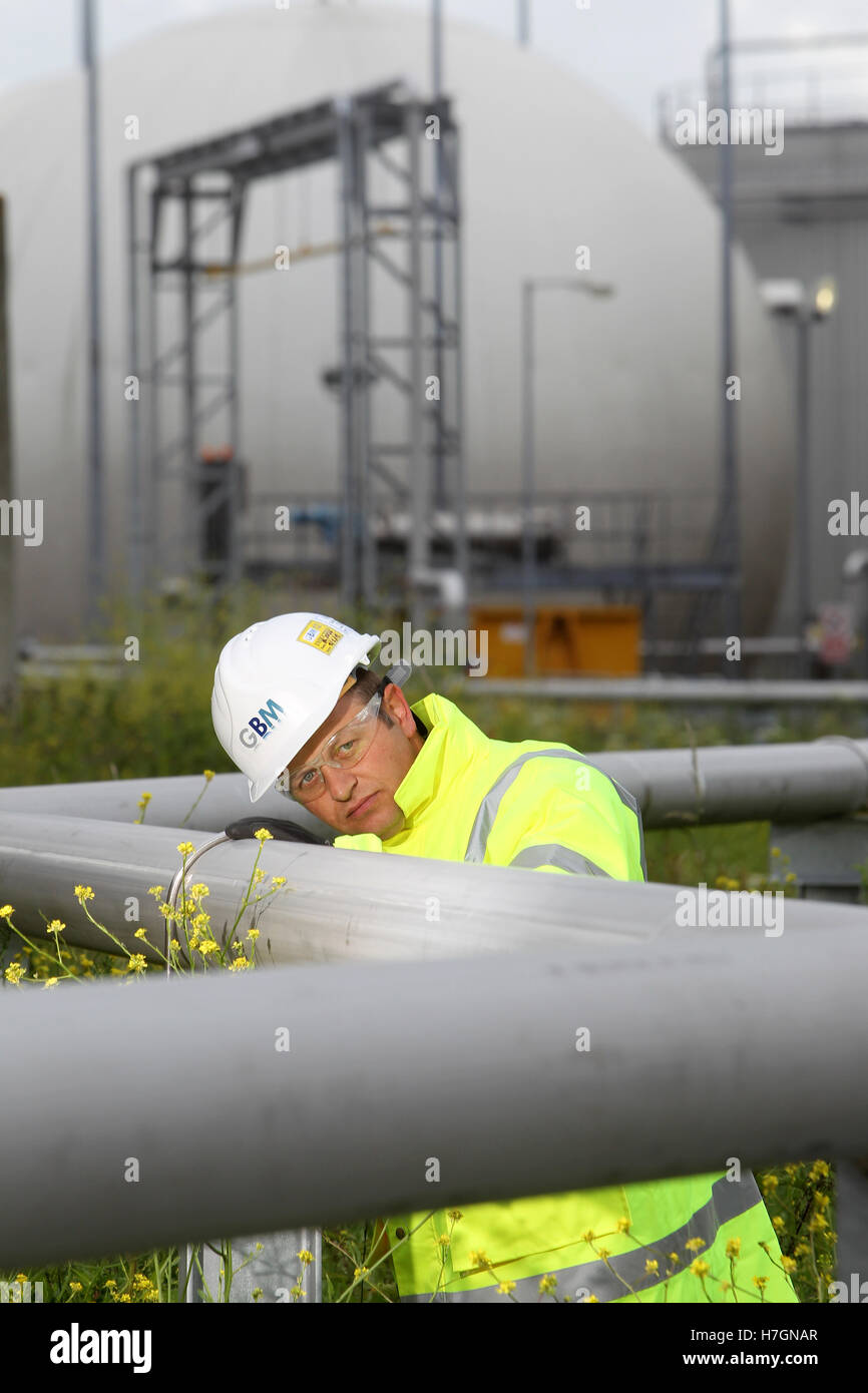 scientist examining pipes at waste water treatment plant - Stock Image