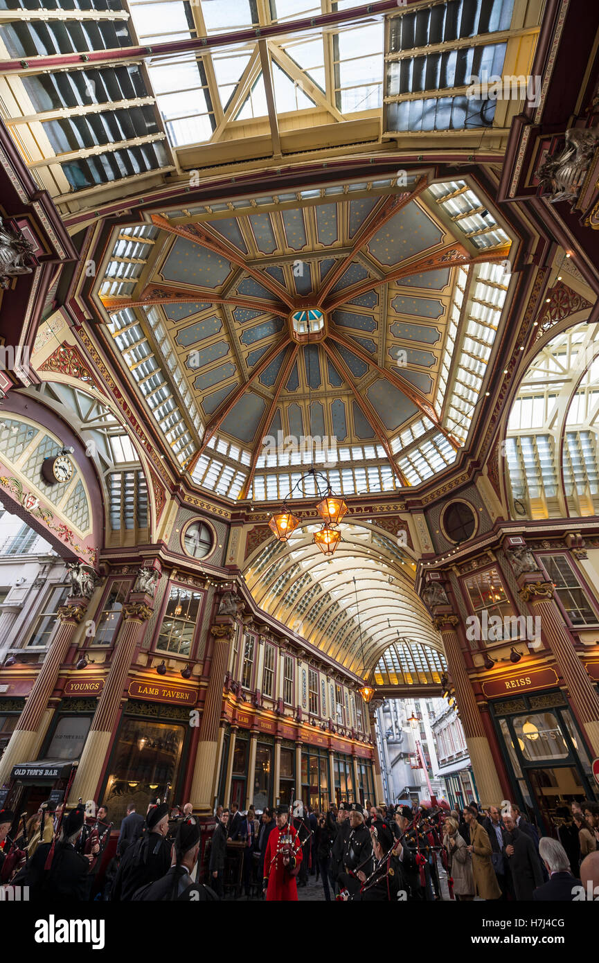 LONDON - NOVEMBER 3, 2016: Visitors gather under the Victorian arcade of the Leadenhall Market, a historic tourist - Stock Image