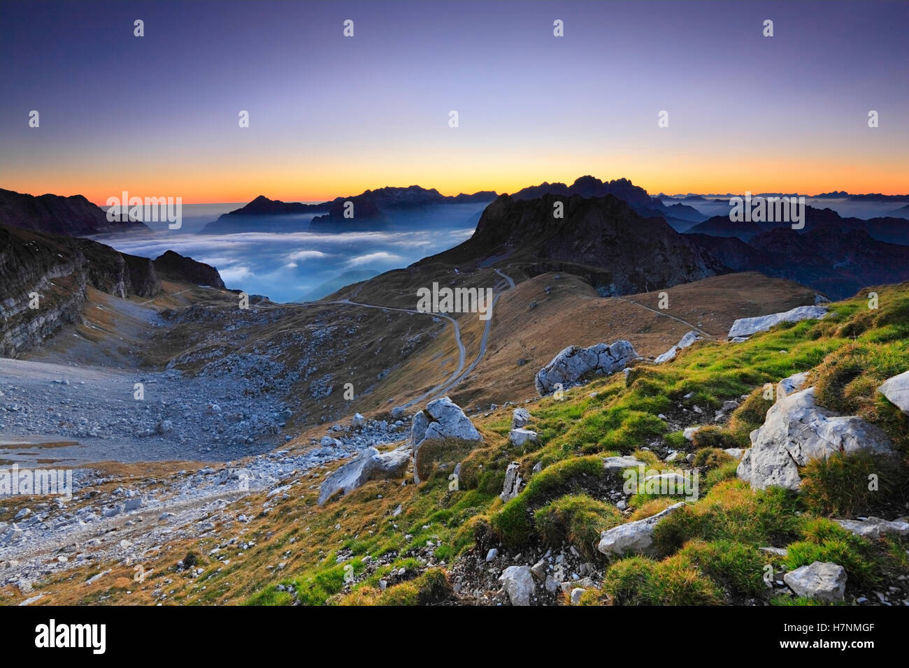 Mountains sunset landscape. Julian alps in Europe. Slovenia and Italy in a distance. Stock Photo