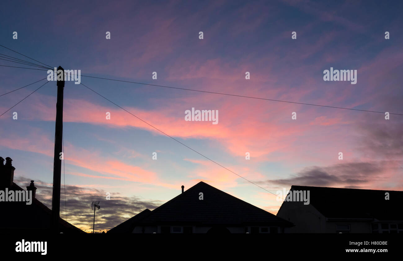 red-sky-sunset-over-silhouetted-houses-m