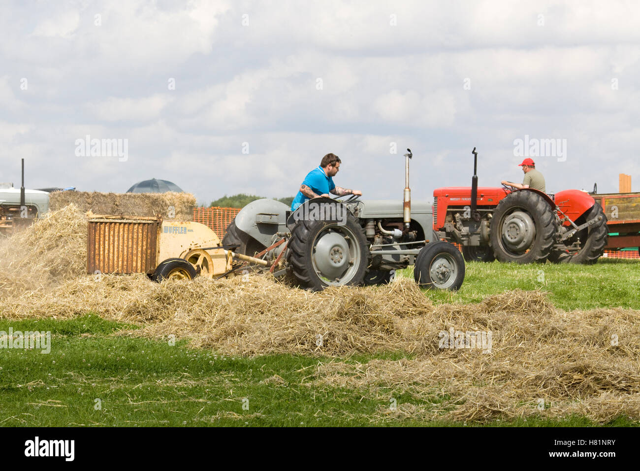 Bamford Wuffler Robust Hay Making Machine, being pulled by a Tractor - Stock Image