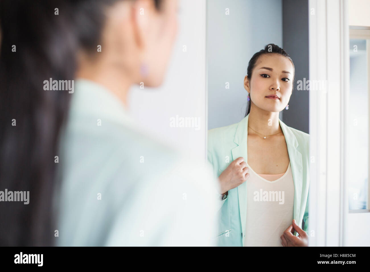 A business woman preparing for work, waking up and dressing. - Stock Image
