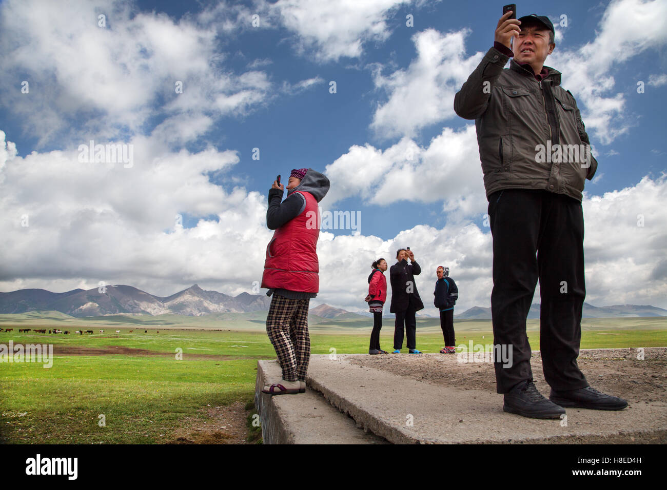 Kyrgyzstan - people trying to get some mobile phone connexion win the middle of nowhere at Song Kol lake - isolated - Stock Image