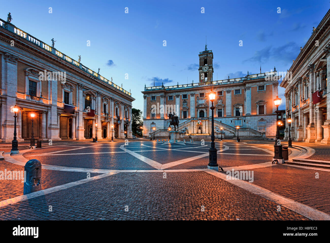 Cobblestone covered square on top of Capitoline hill in Rome, Italy, at sunrise. Historic landmark of ancient roman - Stock Image