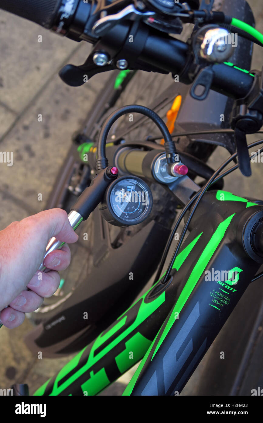 front,use,in,in-use,pumped,up,pumping,apply,pressure,change,hard,tail,hardtail,pumping,Mountain,Bike,cycle,Fox,cycles,suspension,coil,fork,attach,pump,attached,applying pressure,Shock Pump,Pump Your Shock,GoTonySmith,@HotpixUK,Tony,Smith,UK,GB,Great,Britain,United,Kingdom,English,British,England,external,compression,adjuster,adjustment,bicycle,Buy Pictures of,Buy Images Of,Images of,Stock Images,Tony Smith,United Kingdom,Great Britain,British Isles,Buy photo of