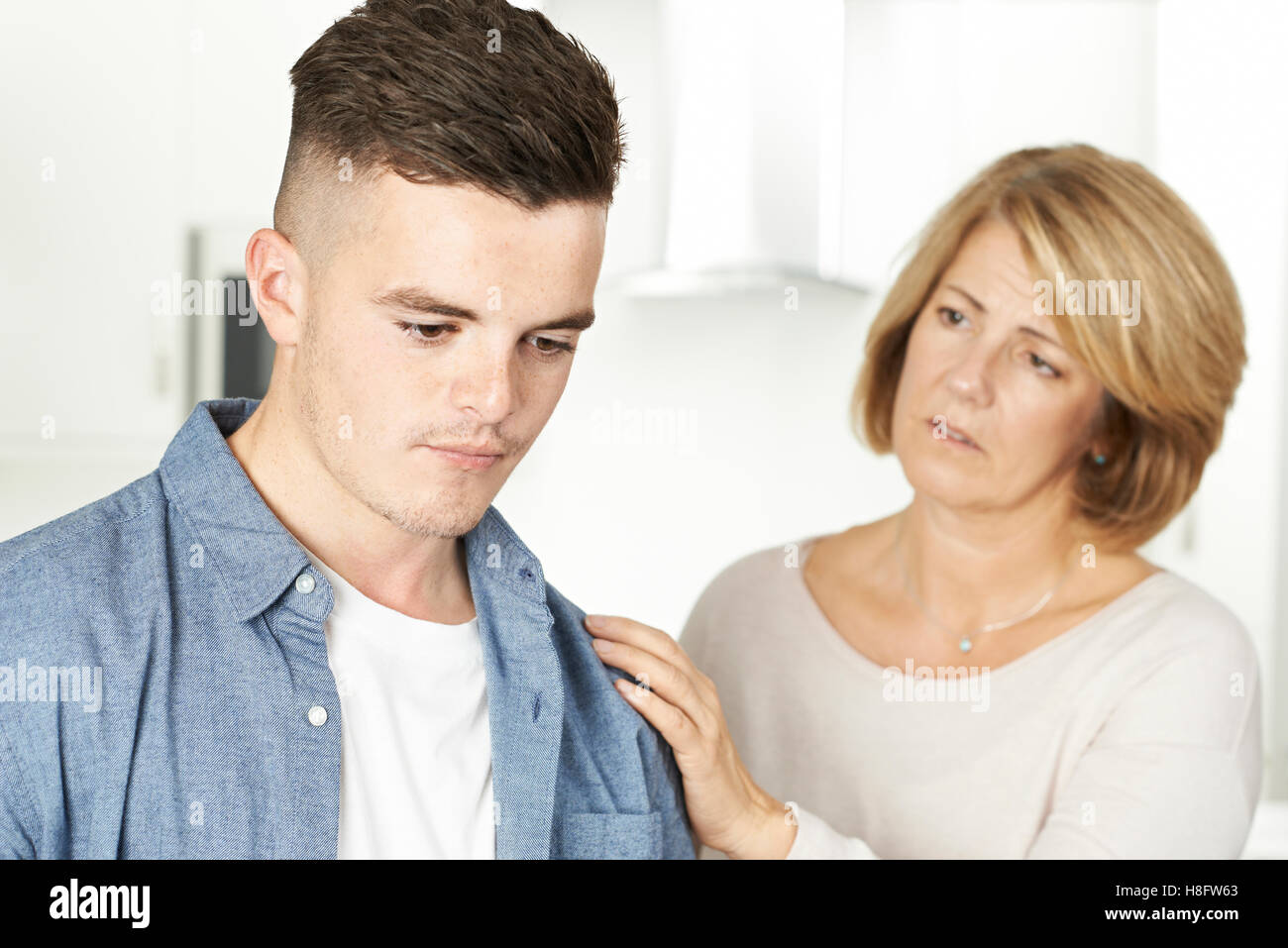 Mother Worried About Unhappy Teenage Son Stock Photo