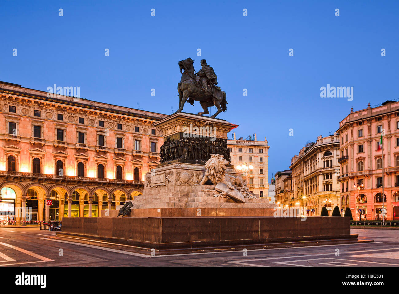 Equestrian statue of Vittorio Emanuele on Cathedral square in Milan, Italy, at sunrise - Stock Image
