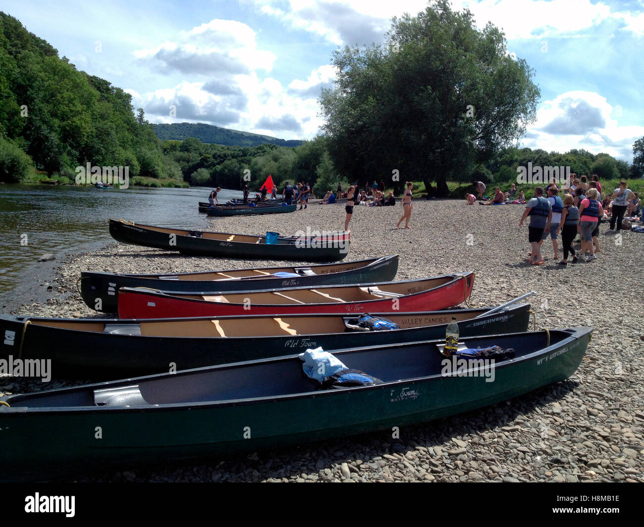 River Wye canoes landing at The Warren Hay-on-Wye Powys Wales UK - Stock Image