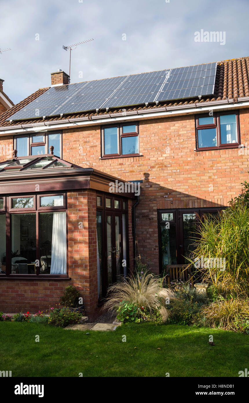 a-view-of-the-rear-of-a-home-with-solar-panels-fitted-H8NDB1.jpg