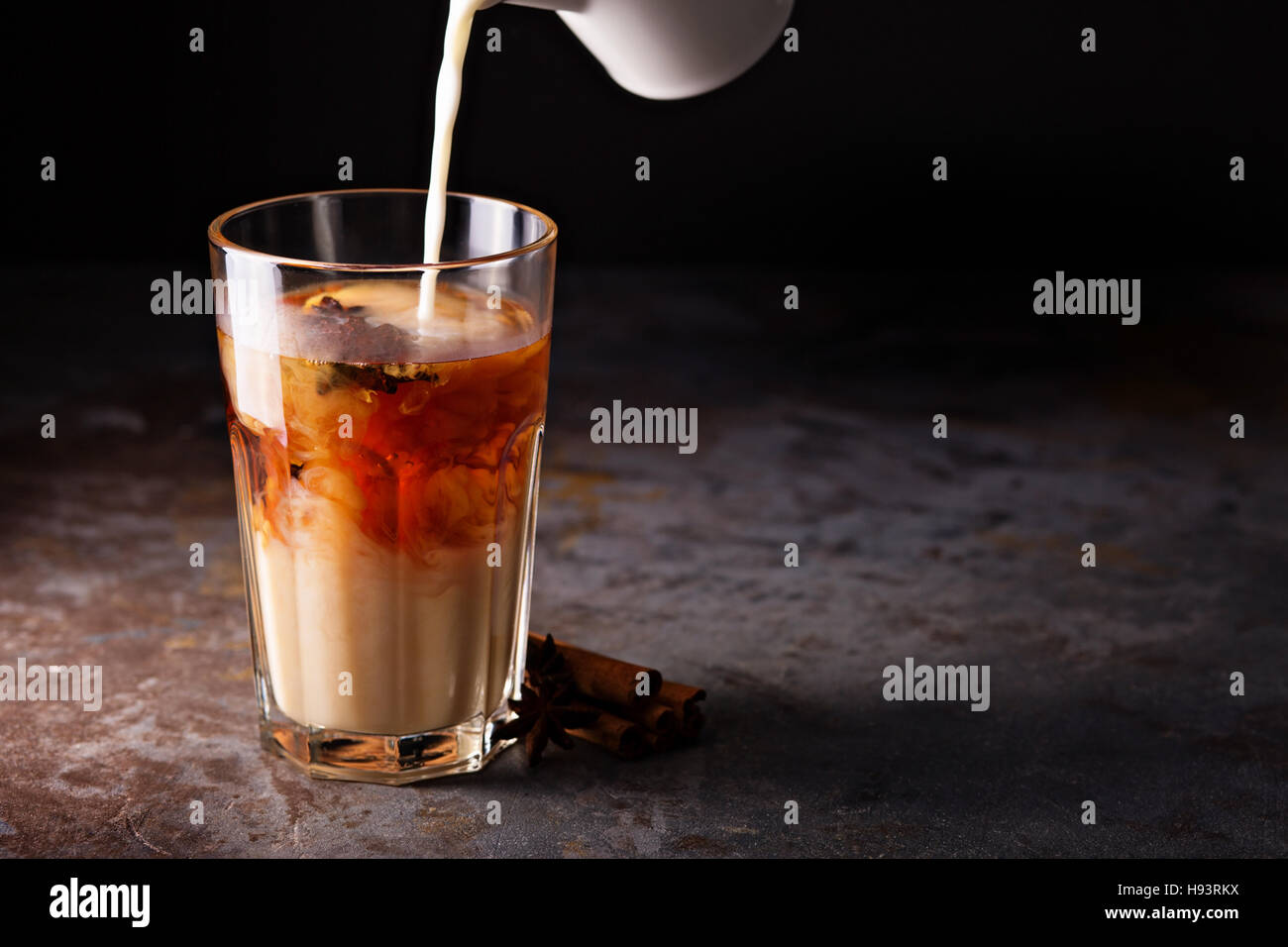 Hot masala tea with milk - Stock Image