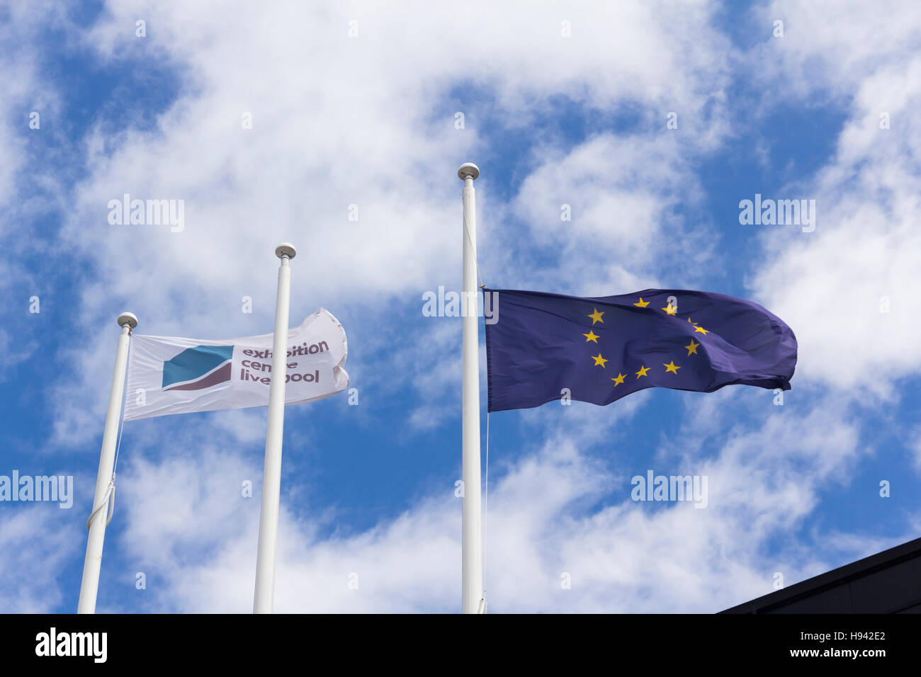 The flag of the European Community flies over Liverpool Exhibition Centre on Kings Dock Liverpool waterfront. - Stock Image