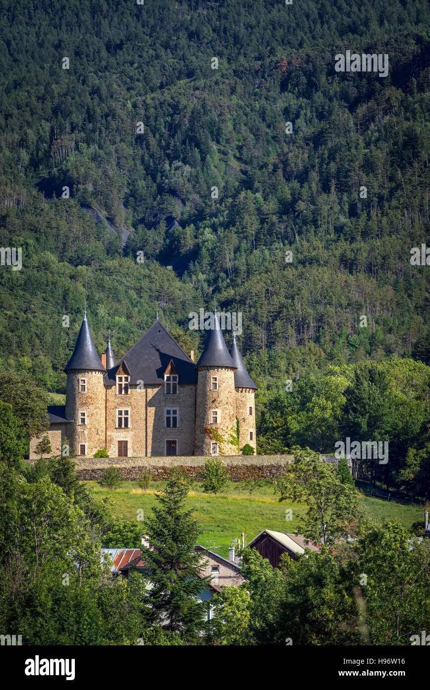 Picomtal Castle and mountain forest in Summer. Les Crots, Hautes Alpes, France Stock Photo