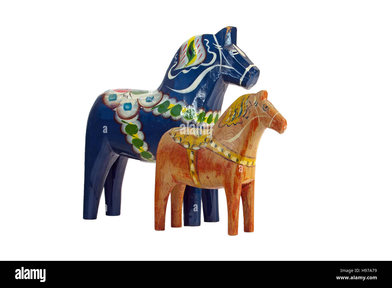 A more modern and blue Dala (Dalecarlian) Horse together with an old red worn Dala Horse, isolated on a white background. Stock Photo