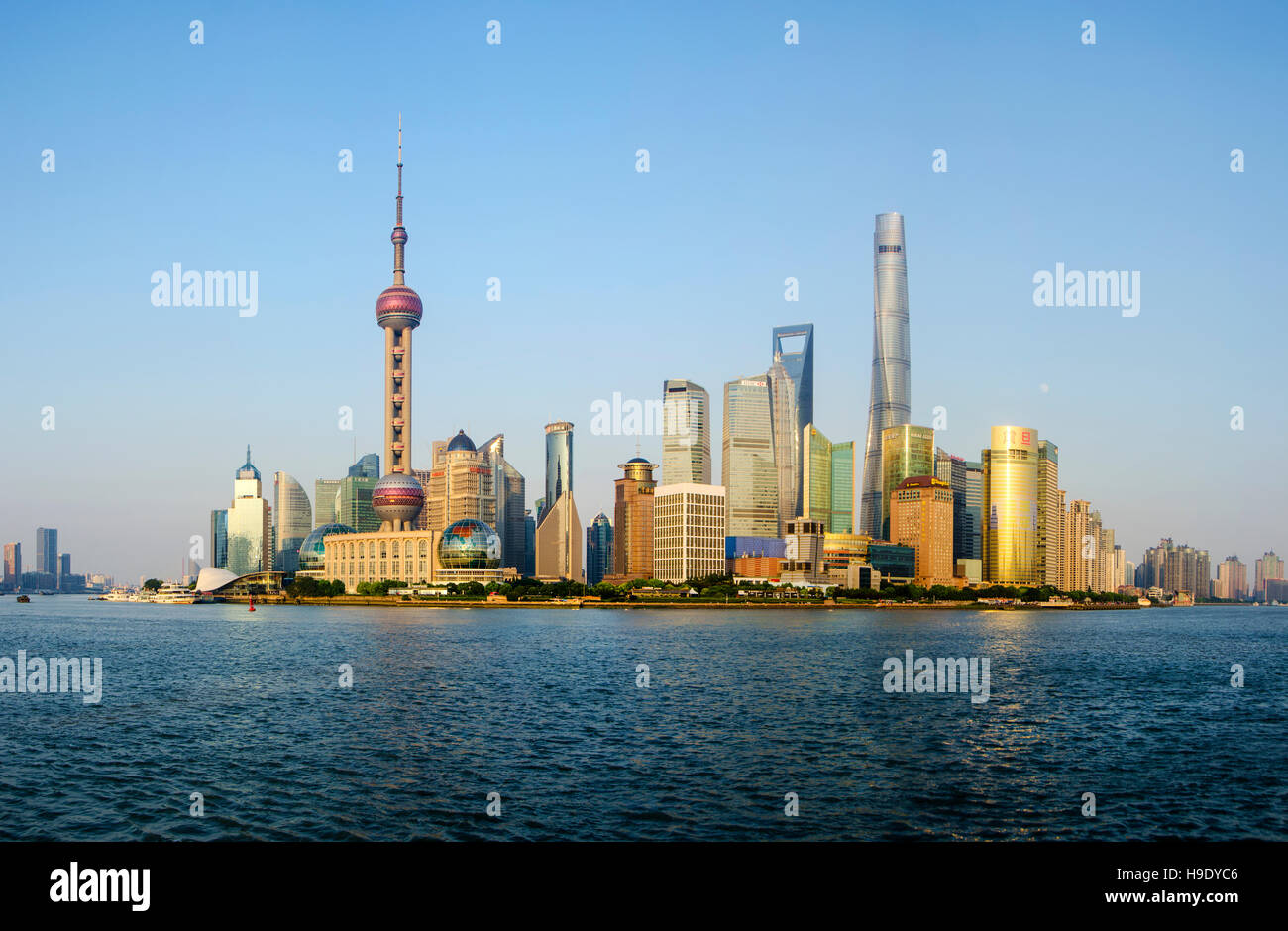 Shanghai Pudong New Skyline of Cityscape in the golden sunshine. The Tallest building is Shanghai Tower located - Stock Image