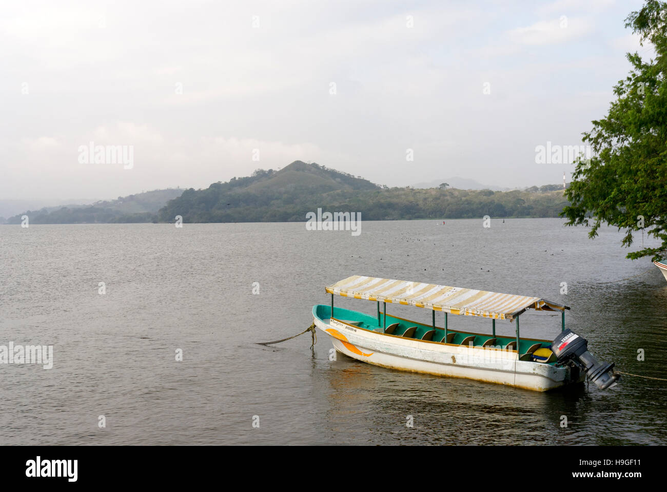 Motorized tourist launch moored on Lake Catemaco on a cloudy day, Catemaco, Veracruz, Mexico Stock Photo