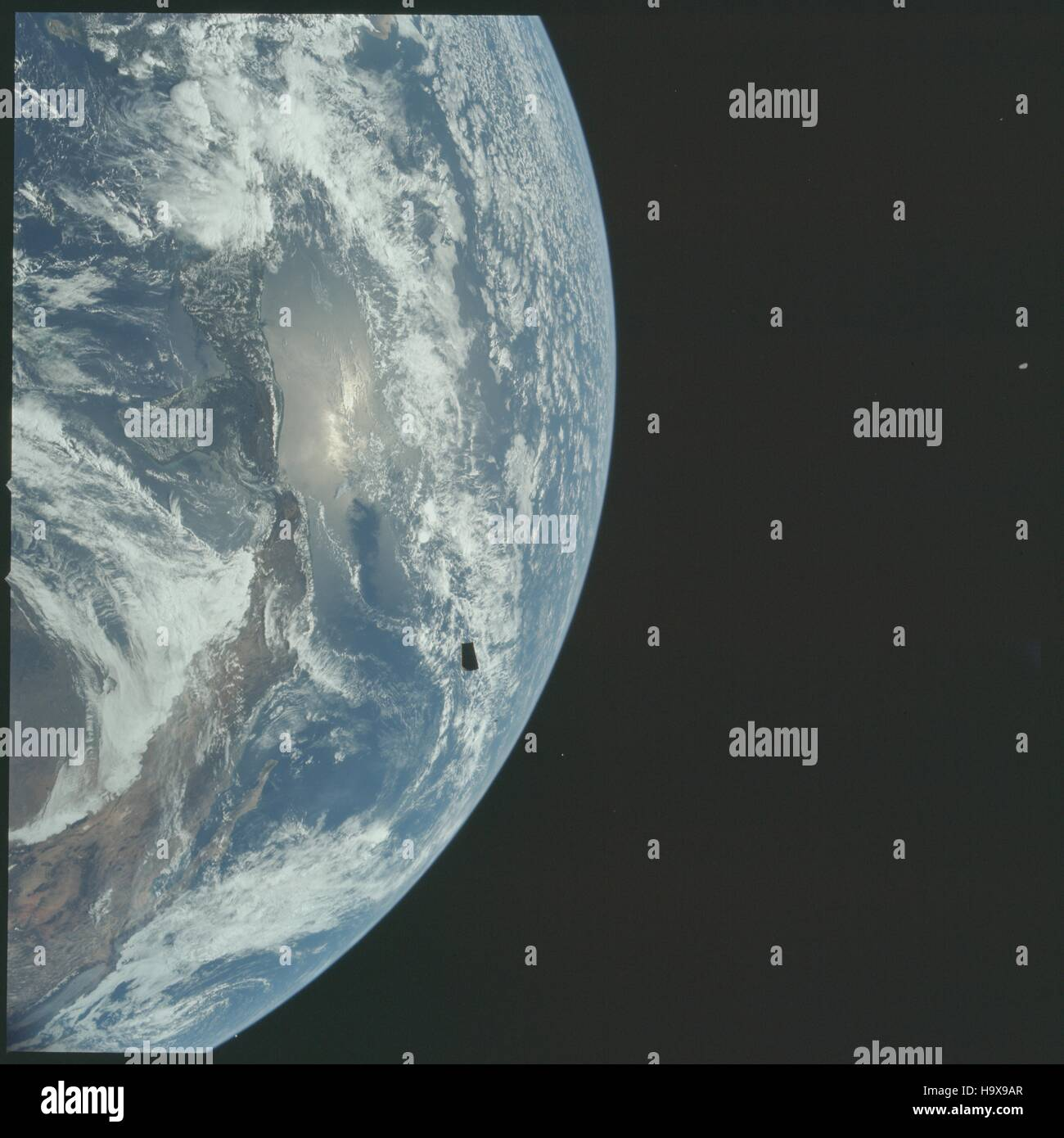 The NASA Apollo 12 mission crew capture a satellite image of the Earth and their Lunar Module adapter panels during - Stock Image