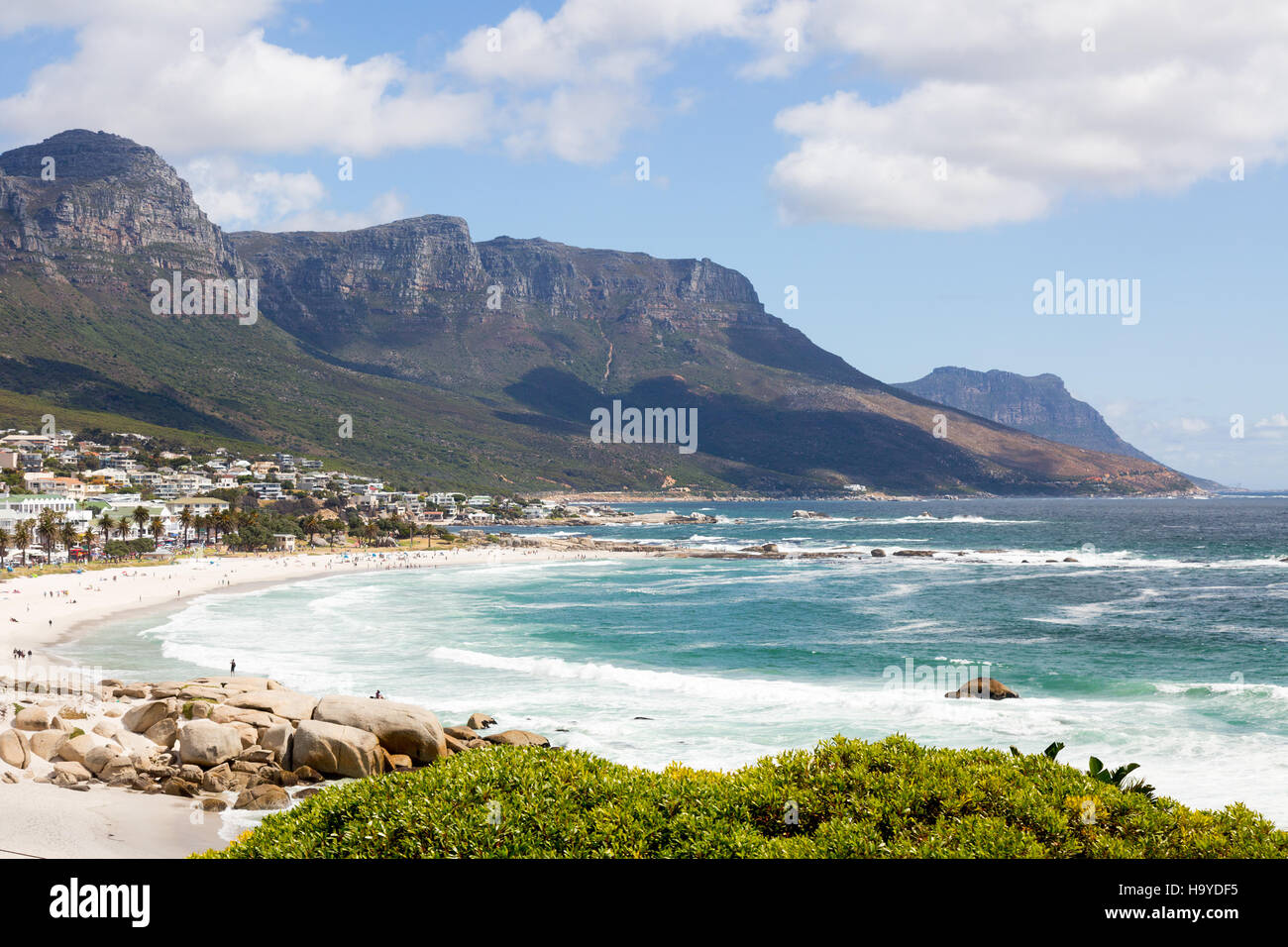 Camps Bay beach and the Twelve Apostles mountains, Cape Town, South Africa - Stock Image