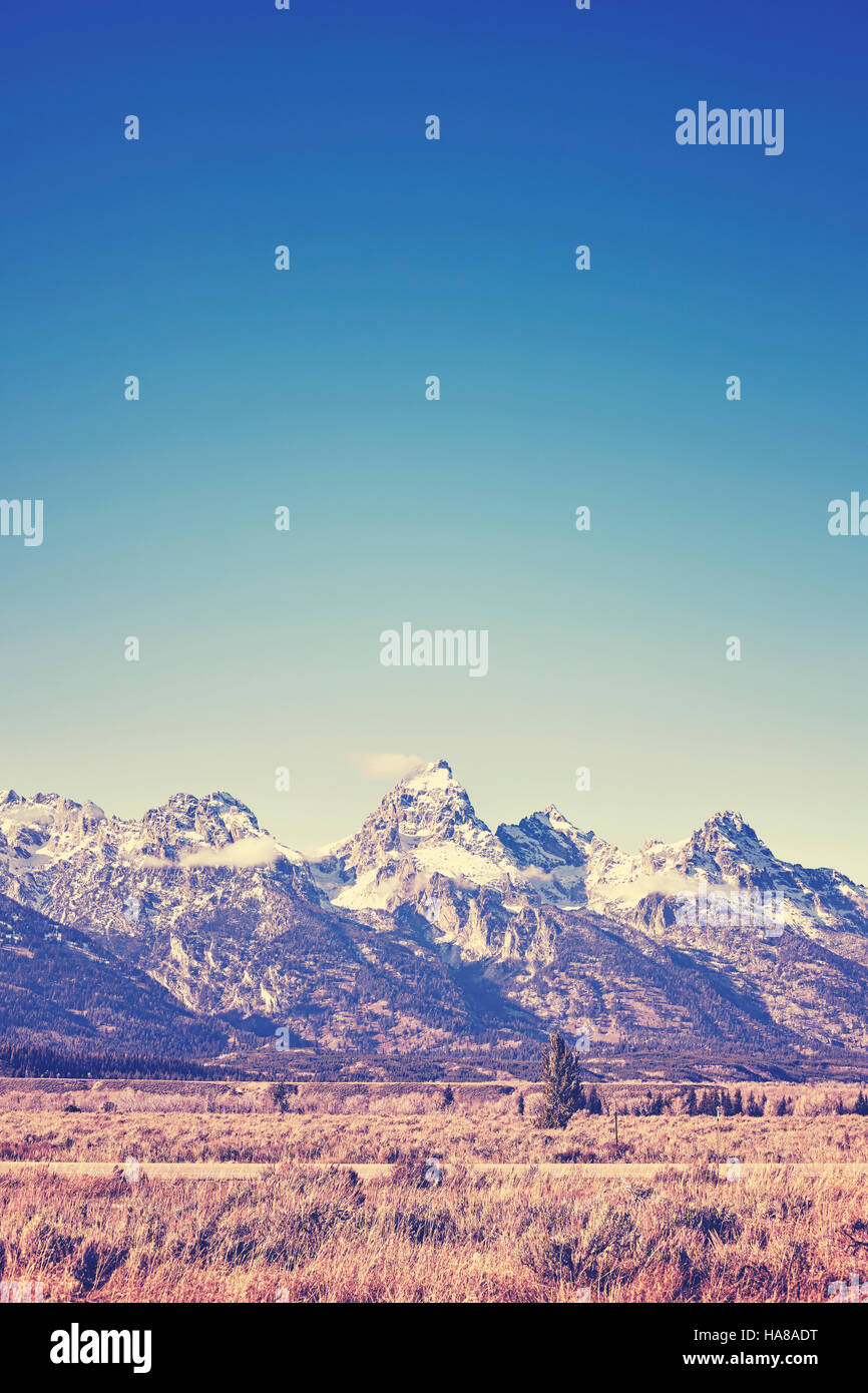 Vintage toned view of Grand Teton mountain range, Wyoming, USA. - Stock Image