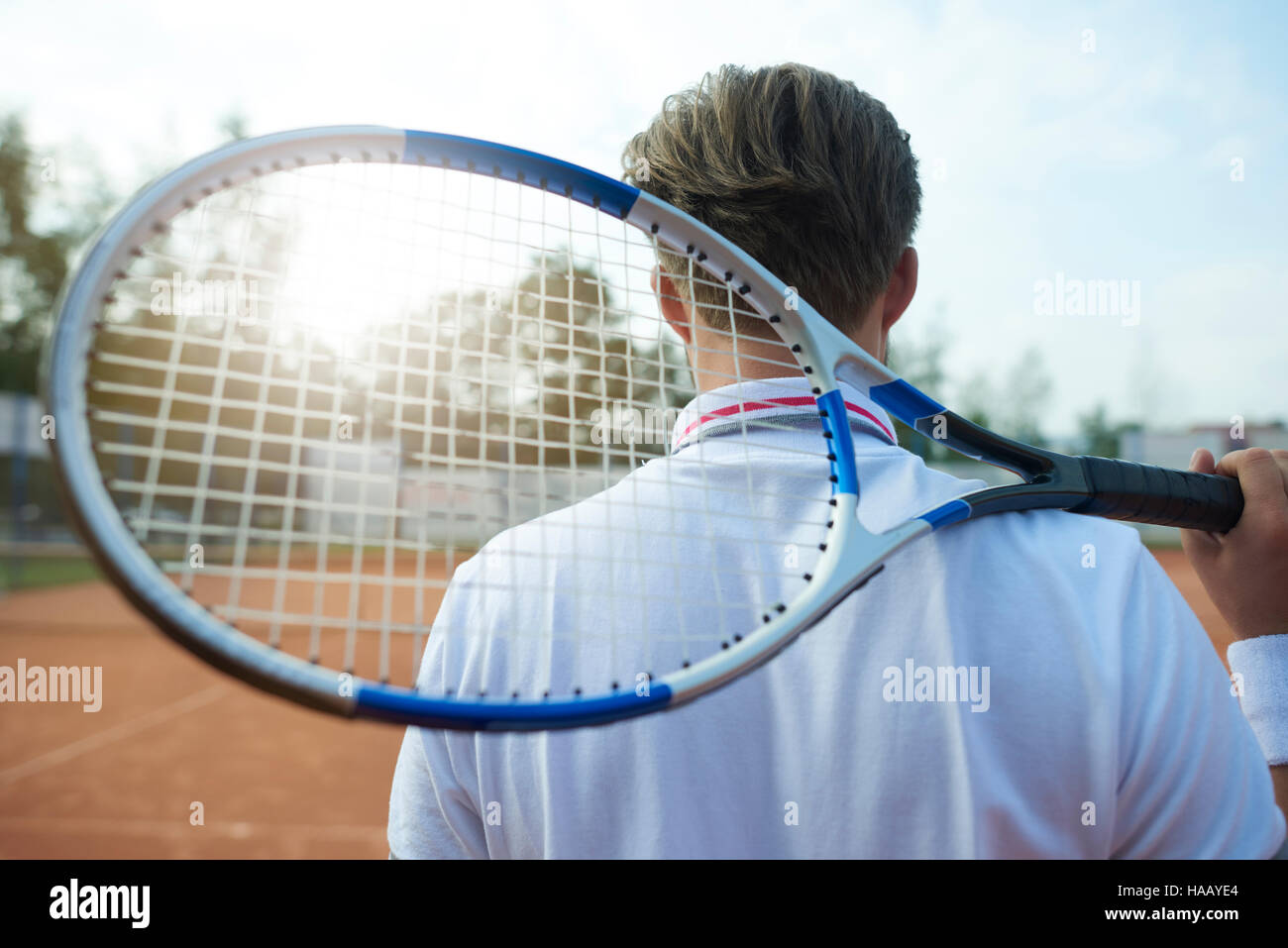 Man is holding a tennis racket - Stock Image