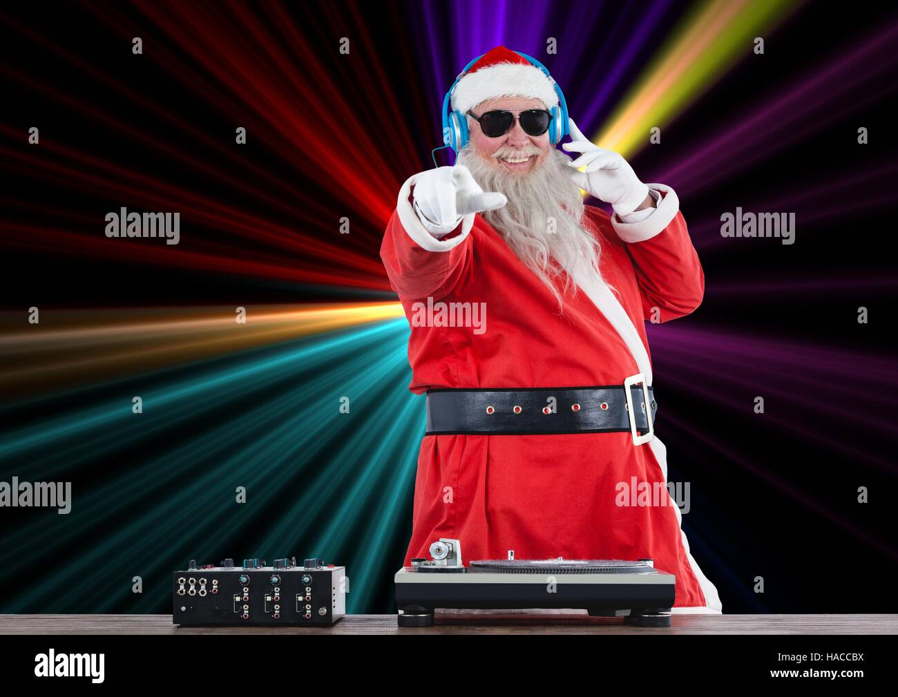 Dj santa claus mixing up some Christmas cheer - Stock Image