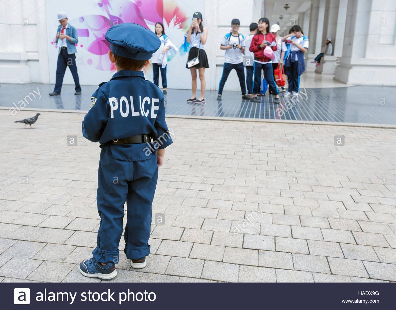 ho-chi-minh-city-hcmc-saigon-vietnam-a-toddler-wearing-a-police-uniform-HADX9G.jpg
