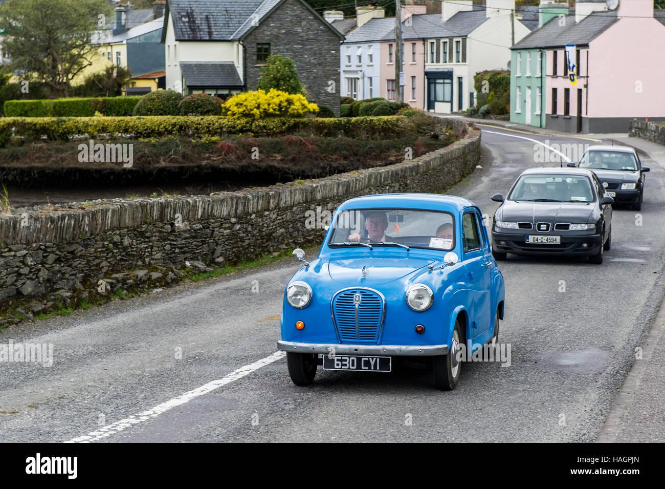 an-old-blue-austin-car-crosses-ballydehob-bridge-west-cork-ireland-HAGPJN.jpg