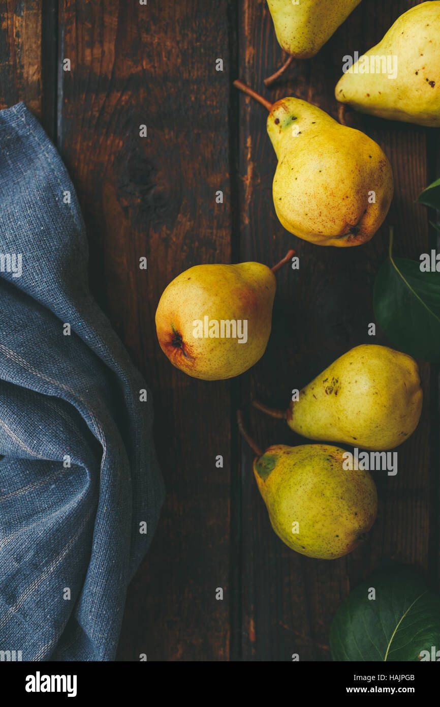 Fresh pears on a wooden surface - Stock Image