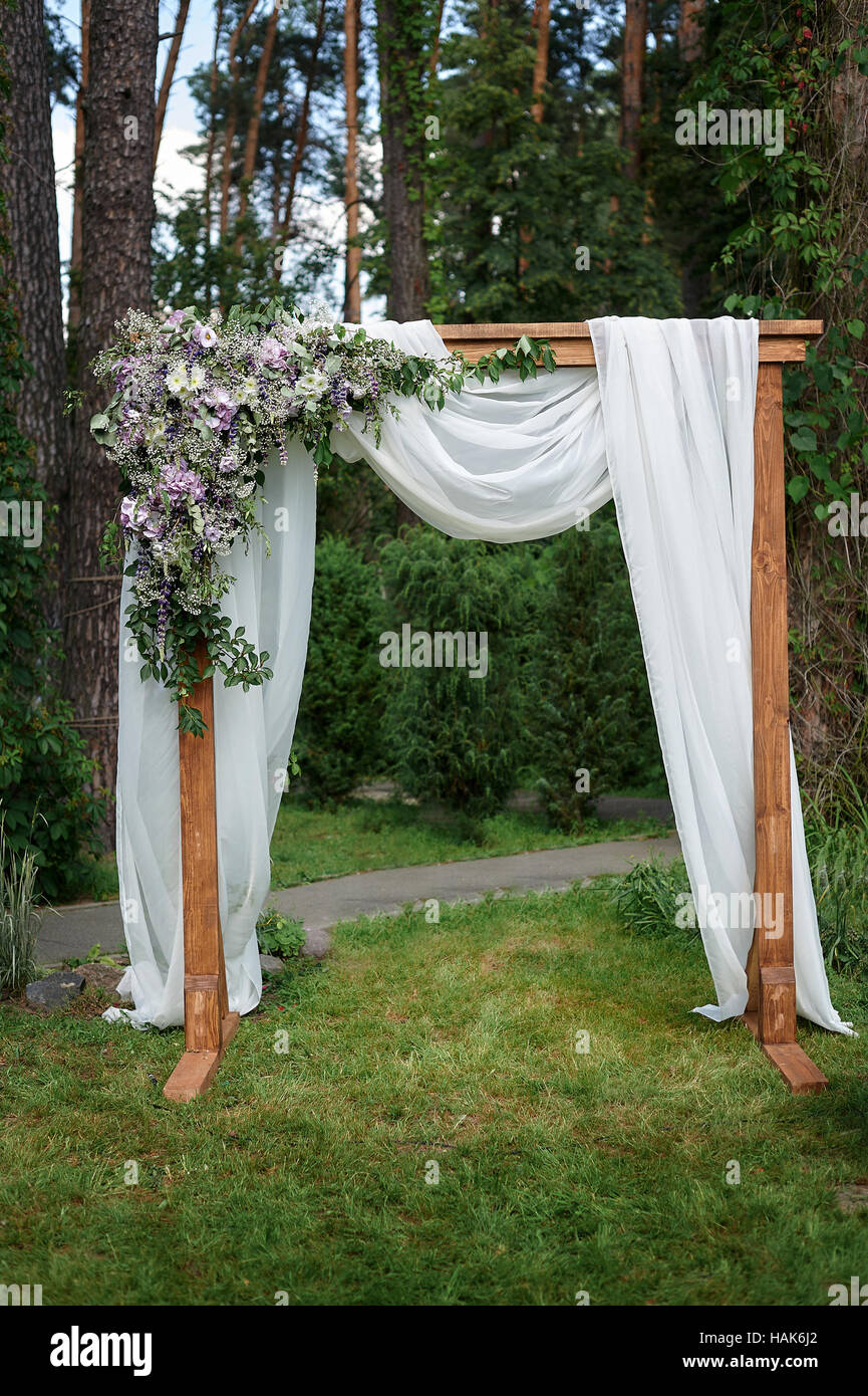 Beautiful wedding arch decorated with flowers in the Park Stock ...