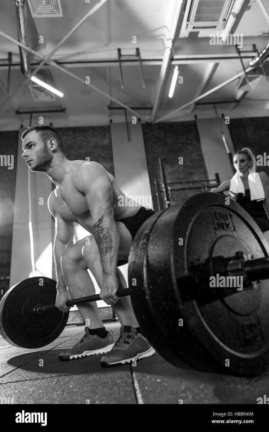 Athletic tattooed man having weightlifting workout - Stock Image